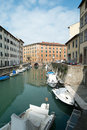 Livorno town italy canals and boats in the venice neighborhood of the city of region of tuscany Royalty Free Stock Image