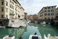 Livorno town italy canals and boats in the venice neighborhood of the city of region of tuscany Stock Photography