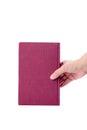 Livro cor de rosa com a mão isolada no branco Imagens de Stock