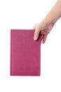 Livro cor de rosa com a mão isolada no branco Fotografia de Stock