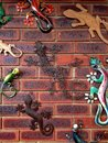 Lizard ornaments covering brick wall sufrace Royalty Free Stock Photo