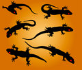 Lizards vector silhouettes of on a color background Royalty Free Stock Photography