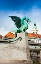 Ljubljana statue on the dragon bridge downtown and zmajski most Stock Image