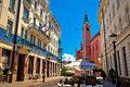 Ljubljana street view with cafe and church Royalty Free Stock Photo