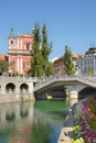Ljubljana with wooden bridge tromostovje and a church behind Royalty Free Stock Photos