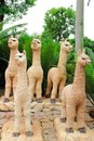 Llama statue the image of the group of in garden at chonburi Stock Photo