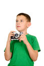 Llittle caucasian boy taking photos by vintage camera in green t shirt isolated on white Stock Image