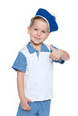 Llittle cheerful boy in a sailor suit portrait of little holding his thumb up on the white background Royalty Free Stock Photo