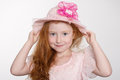 Llittle girl of six years in a hat adorable little on gray background Royalty Free Stock Photo