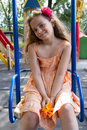 Llittle girl swinging on the playground cute little schoolgirl at summer day Royalty Free Stock Photography