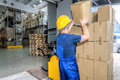 Load of boxes packages doing by a worker in the warehouse Royalty Free Stock Images