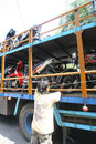 Load motorcycle workers the bike up truck to be shipped out of town in the city of solo central java indonesia Stock Image