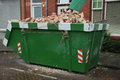 Loaded dumpster near a construction site home renovation Royalty Free Stock Image