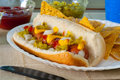 Loaded hot dog with chips Royalty Free Stock Photos