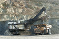 Loader and haul truck at the opencast mining in sumbawa Stock Photos