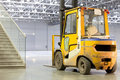 Loader in modern storehouse Royalty Free Stock Photo