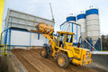 Loader works at concrete plant Royalty Free Stock Photo