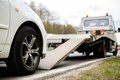 Loading broken car on a tow truck Royalty Free Stock Photo