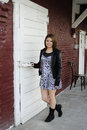 Loading dock beauty a beautiful young teen ready to open a door on an old warehouse Royalty Free Stock Photos