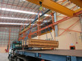 Loading goods work overheadcrane and truck outside of warehous Royalty Free Stock Images
