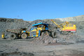Loading of iron or ore on very big dump body truck Royalty Free Stock Images