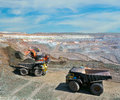 Loading of iron ore on very big dump body truck Royalty Free Stock Image