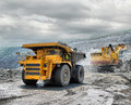 Loading of iron ore on very big dump body truck Royalty Free Stock Photography