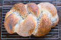 Loaf of braided bread a fresh with various seeds Royalty Free Stock Images