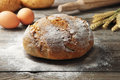 Loaf bread freshly baked of homemade on a wooden table rustic style closeup Royalty Free Stock Images