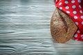 Loaf of bread polka-dot napkin on vintage wooden board