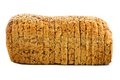 Loaf of bread sliced with grains over a white background Royalty Free Stock Photo