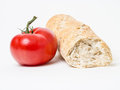 Loaf of bread and tomato Stock Images