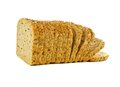 Loaf of bread toppling slices a over a white background Royalty Free Stock Photos