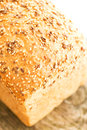 Loaf of bread on wooden table top view composition with Stock Photo