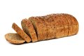 Loaf of sliced whole grain bread with flax seeds, isolated Royalty Free Stock Photo