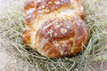 Loaf of sweet christmas bread lying on hay festive dessert Royalty Free Stock Image