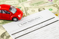 Loan application form with car and cash Royalty Free Stock Photo