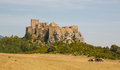 Loarre castle in loarre spain with grazing horses the of dates from the eleventh to twelfth century and was built by the spanish Royalty Free Stock Photography
