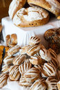 Loaves of artisan bread many on a table at a bakery Stock Photo