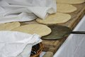 Loaves of leavened bread ready to be fired by baker Stock Photo