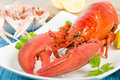 Lobster and langoustines with browned butter lemon wedges in background Stock Photos