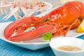 Lobster and langoustines with browned butter lemon wedges in background Stock Photo