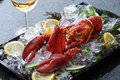 Lobster with lemon on the plate Royalty Free Stock Images