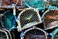 Lobster pot and creel stack in a fishing village Royalty Free Stock Image
