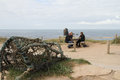Lobster pot and people by Thurlestone rock Devon.