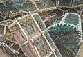Lobster pots on a quayside commercial fishing stacked of fishing port Royalty Free Stock Images