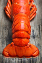 Lobster tail photo of a on wood Stock Photos