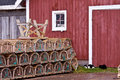 Lobster traps and two kitty cats in front of shed, Prince Edward Island, Canada Royalty Free Stock Photo