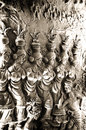 Local artwork clay sculptures on mud walls travel asia of in indonesia showing women dancing in flute tunes Stock Image