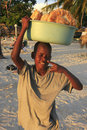 Local boy selling bread at boca chica beach dominican republic Royalty Free Stock Photography